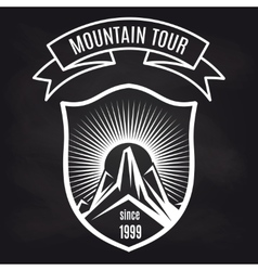 Travel label with mountain on blackboard vector image