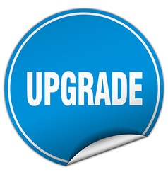 Upgrade round blue sticker isolated on white vector