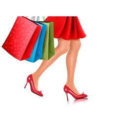Waist-down view of shopping woman wearing red high vector image