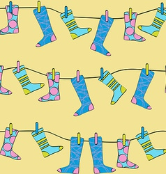Seamless Pattern Socks Drying on the Clothesline vector image