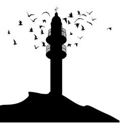 lighthouse silhouette and birds flying around it vector image