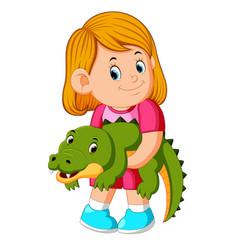 a little girl holding crocodille vector image