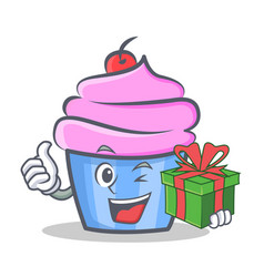 cupcake character cartoon style with gift vector image