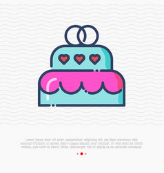 wedding cake with two rings on top vector image