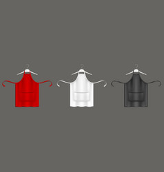 Chef aprons black red white uniform on hangers vector