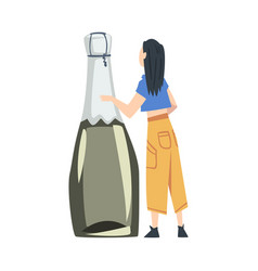 back view tiny woman holding huge bottle of vector image