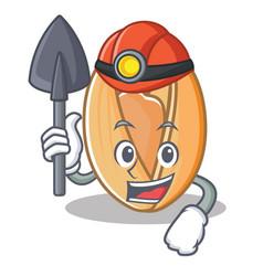 Miner pistachio nut mascot cartoon vector