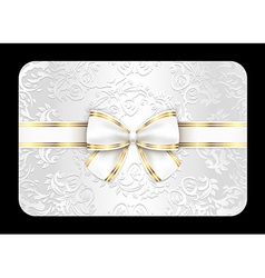 White card with ornament and white ribbon vector