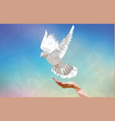 polygonal dove with human hand flying in blue sky vector image