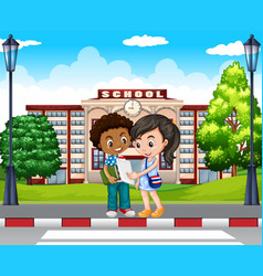 Two kids in front of the school vector