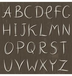 Decorative alphabet on wooden background vector image