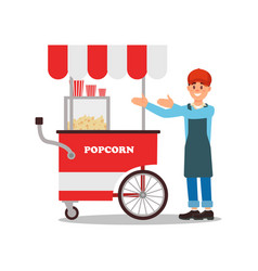 friendly seller standing near mobile popcorn cart vector image