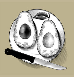 Two cut avocado halves and a knife on a round vector