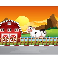 A cow beside the wooden barnhouse vector