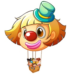 A big clown balloon with a basket full of happy vector image vector image