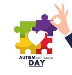 Autism awareness day hand holding puzzle piece vector