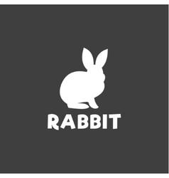 Silhouette a rabbit sitting under logo pet vector