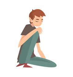 Unhappy sad boy sitting on floor depressed vector
