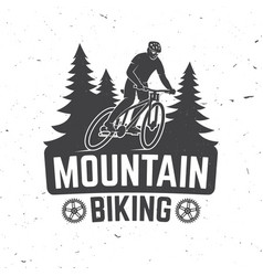 vintage typography design with man riding bike and vector image