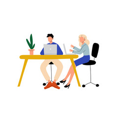 young man and woman sitting at desk with computers vector image