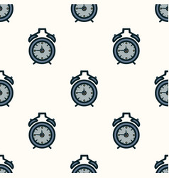 seamless pattern of alarm clocks on the vector image vector image