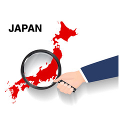 hand use magnifying glass searching on japan map vector image