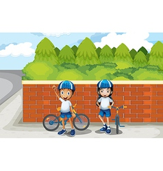 Two young bikers at the street vector image