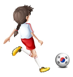 A girl kicking the ball with the South Korean flag vector image