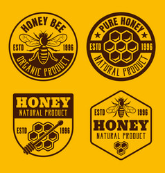 Four honey and beekeeping badges emblems labels vector