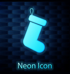 glowing neon christmas sock icon isolated on brick vector image