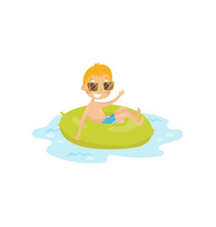 funny kid swimming at sea on green inflatable ring vector image