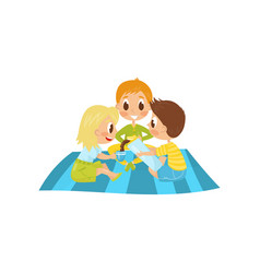 Little kids sitting on picnic carpet and drinking vector