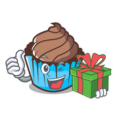 With gift chocolate cupcake mascot cartoon vector
