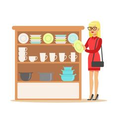 woman choosing tableware smiling shopper in vector image