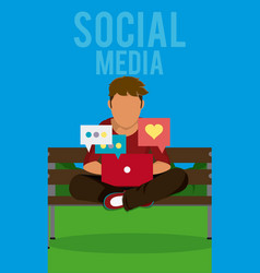 Young man seated at park with laptop vector
