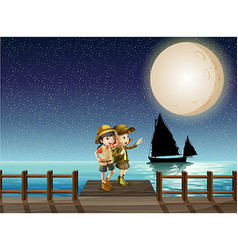 Two girls looking at fullmoon on the pier vector