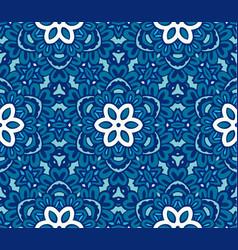 Blue an white geometric flower pattern vector