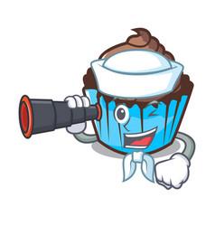Sailor with binocular chocolate cupcake mascot vector