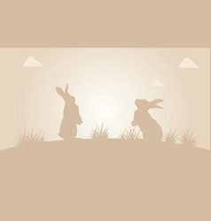 Silhouette of easter bunny at sunset vector