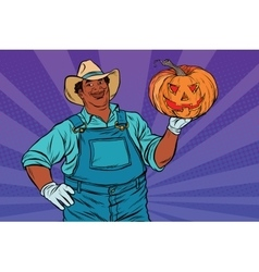 African American farmer with a Halloween pumpkin vector