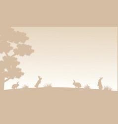 Silhouette of bunny on garden landscape vector