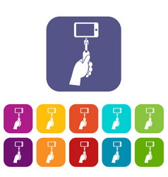hand holding a selfie stick with mobile phone set vector image