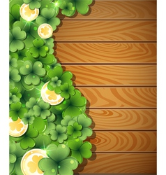 Magic clover on wooden background vector
