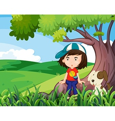 A young girl and her pet under the tree vector image