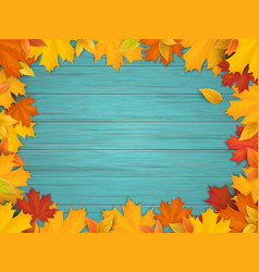fallen leaves on turquoise wooden background vector image