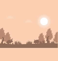 Silhouette of bunny at sunset landscape vector