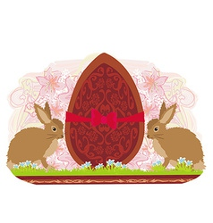 chocolate egg with red bow and two beautiful vector image vector image