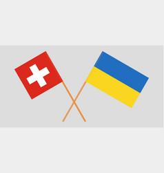 Crossed flags ukraine and switzerland vector