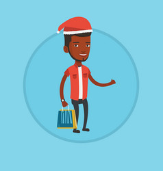 Man in santa hat shopping for christmas gifts vector