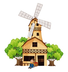 A big wooden house with a windmill vector image vector image